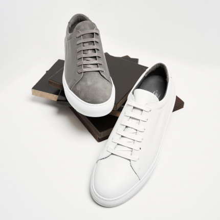Meet Grey & Monochrome White. They've got an upgrade while staying in trend and style combined with traditional craftsmanship from The Cobbler.   #sneakerdisplay #sneaker #uae #dubai #thecobbler #craftmanship #storytelling #heritage #abudhabi